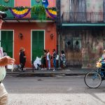 colorful man walking in the French Quarter of New Orleans